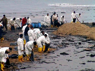 Cleaning oil from the Gulf's shoreline