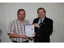 Mark Bell receiving his certificate from Baseefa's Ron Sinclair