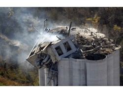 The trackside explosion at the Atchison elevator killed six and seriously injured another two workers