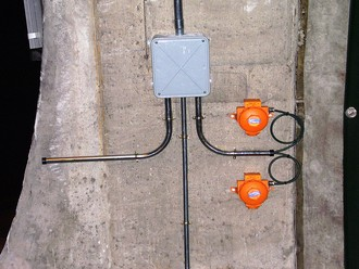 Two Crowcon Xgard detectors on tunnel wall